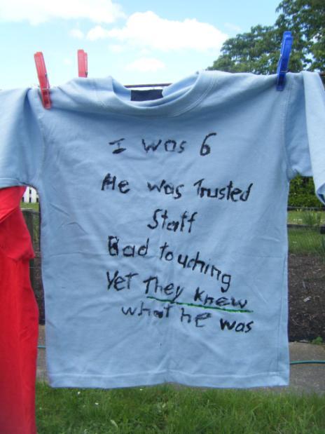 tee shirt on clothesline, text and description follow