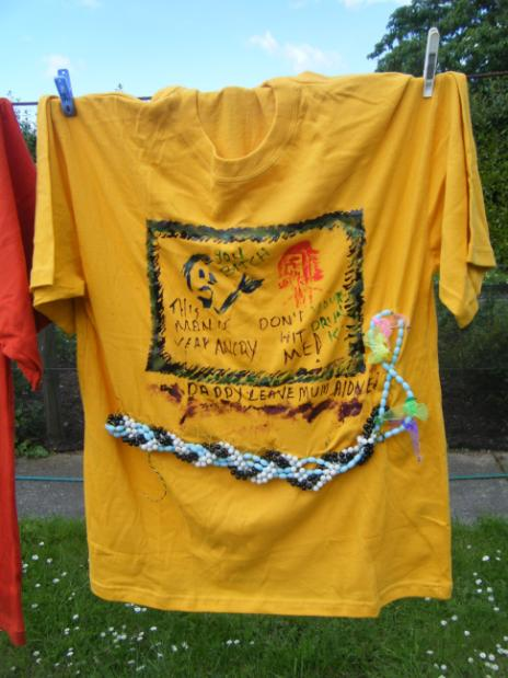 tee shirt on clothesline, text and description follow